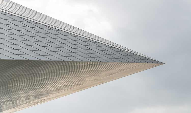 Photograph of a skyscraper, taken at at angle, to resemble an arrowhead