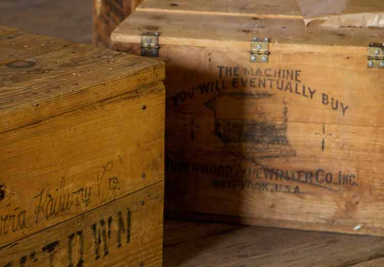 Wooden crates for typewriters on a wood floor