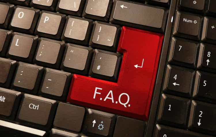 A keyboard with a red FAQ key