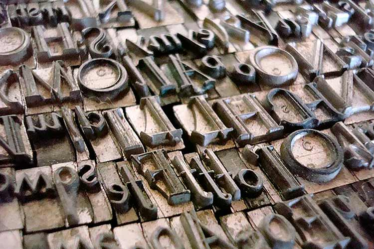 A stack of letterforms, used in a letterpress